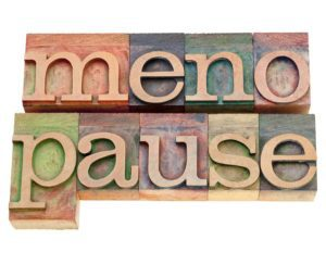 menopause - isolated word in vintage wood letterpress printing blocks stained by color inks